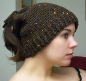 2fc7a3b6ceb Make Your Own Awesome Ponytail Hat With These Crochet. On Trend Messy Bun  ...